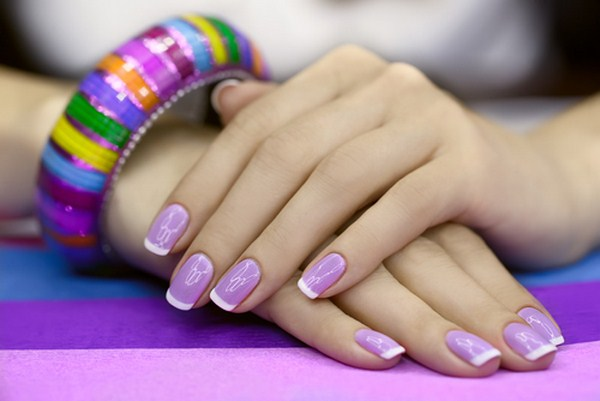 Beautiful-womens-manicure-with-purple-polish-on-the-nails (Copy)