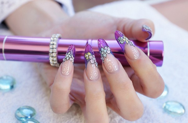 female-hand-with-stunning-purple-see-through-floral-nail-art-design (Copy)