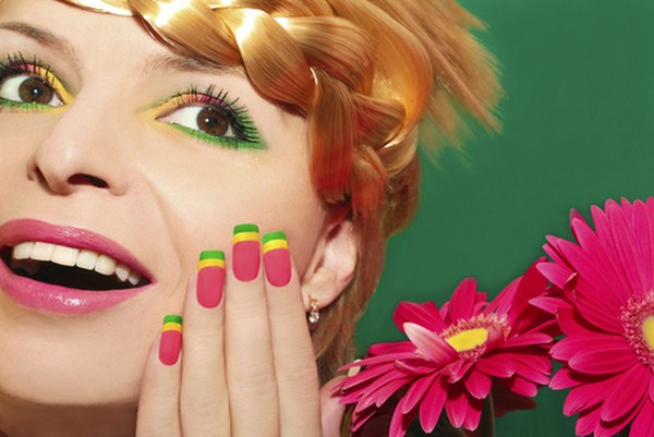 Beautiful-summer-makeup-with-pink-lips-and-colorful-nails-on-a-beautiful-young-girl-with-braids-on-his-head (Copy)